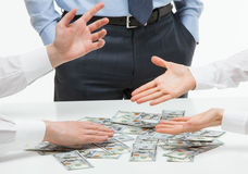 Business people sharing money. White background royalty free stock image