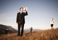Business People Shouting Through Paper Megaphone.  Royalty Free Stock Image