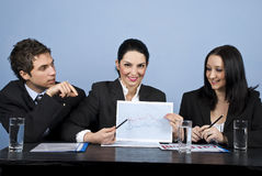 Business people show financial chart at meeting Stock Images