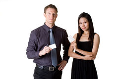 Business people showing blank  business card. Businessman in formal suit and woman in dress showing business card Stock Photo