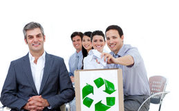 Business people showing the concept of recycling. Confident business people showing the concept of recycling against a white background Royalty Free Stock Image