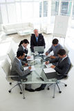 Business people showing diversity in a meeting. High angle of a business people showing diversity in a meeting Royalty Free Stock Photo