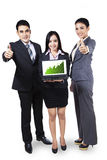 Business people showing graph on laptop Royalty Free Stock Image