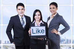 Business people showing like on laptop. Group of asian business people showing like on laptop at office stock photography