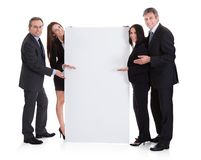 Business people showing placard Royalty Free Stock Photography