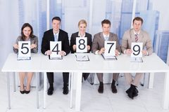 Business people showing score cards Royalty Free Stock Photography