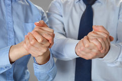 Business people showing supportive sign Stock Photo