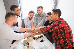 Business people showing teamwork in office Royalty Free Stock Image