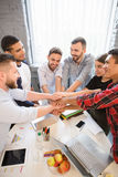Business people showing teamwork in office Royalty Free Stock Photography