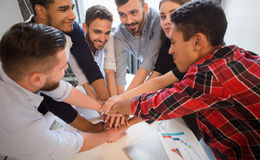 Business people showing teamwork in office Royalty Free Stock Photo