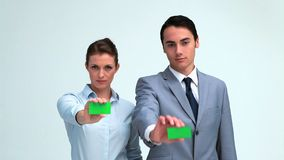 Business people showing their business card. In studio stock video