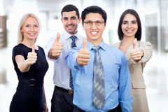 Business people showing thumbs up sign Stock Photos