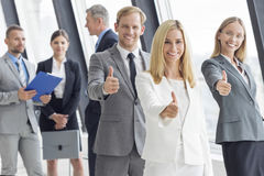 Business people showing thumbs up Royalty Free Stock Photos