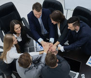 Business people showing unity with their hands together Royalty Free Stock Photo