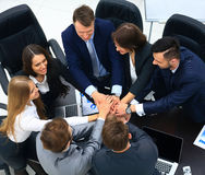 Business people showing unity with their hands together Stock Images