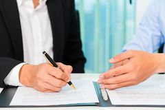 Business people sign agreement Stock Photography
