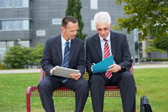 Business people signing contract Stock Photography