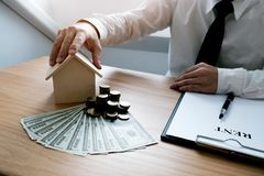 Business people signing contract making a deal with real estate stock photo