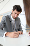 Business people signing contracts Stock Photos