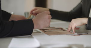 Business People Signing Contracts Together Concluding Deal By Firm Handshake stock video