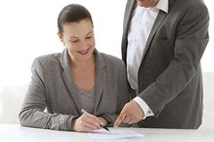 Business people signing documents Stock Photo
