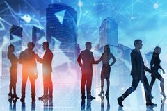 Business people silhouettes in blue city, network stock image