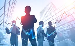 Business people silhouettes in city, stock market. Diverse and confident young business team silhouettes over skyscraper background with forex graphs. Concept of stock image