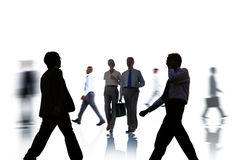 Business People Silhouettes Commuting and Isolated on White Stock Images