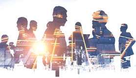 Business people silhouettes, glowing city plan