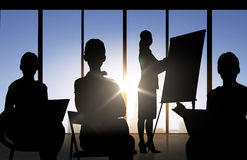 Business people silhouettes at meeting in office stock illustration