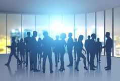 Business people silhouettes in night office Stock Photography