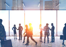 Business people silhouettes in office hall, city Royalty Free Stock Image