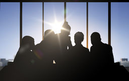 Business people silhouettes over office background Royalty Free Stock Image