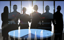 Business people silhouettes with pie chart Stock Images