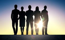 Business people silhouettes on stairs over sun Stock Photos