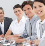 Business people sitting around a conference table. International business people sitting around a conference table. Business concept stock images