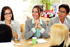 Business people sitting around the table Royalty Free Stock Photos