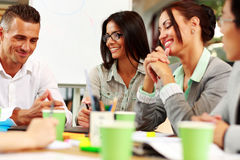 Business people sitting around the table at the meeting Royalty Free Stock Photos