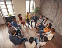Free Business People Sitting At Circle In Board Room And Discussing Royalty Free Stock Image - 128649756