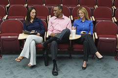 Business People Sitting In Auditorium Royalty Free Stock Images