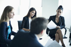 Business people sitting in a business meeting Royalty Free Stock Photos