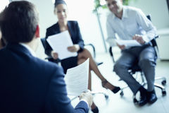 Business people sitting in a business meeting, tilt Royalty Free Stock Photos