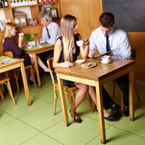 Business people sitting in café Stock Images