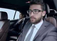 Business people sitting in car Royalty Free Stock Image