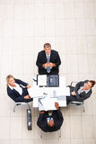 Business people sitting on chair and looking up Royalty Free Stock Photos