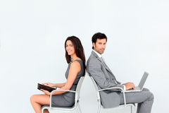 Business people sitting in chairs Stock Image