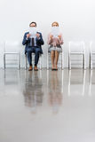 Business people sitting on chairs stock photography