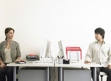 Business People Sitting At Computer Desks royalty free stock photography