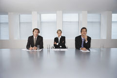Business People Sitting At Conference Table Stock Photo
