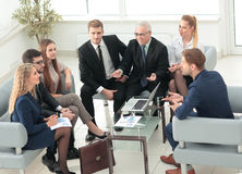 Business people sitting at corporate meeting Stock Image